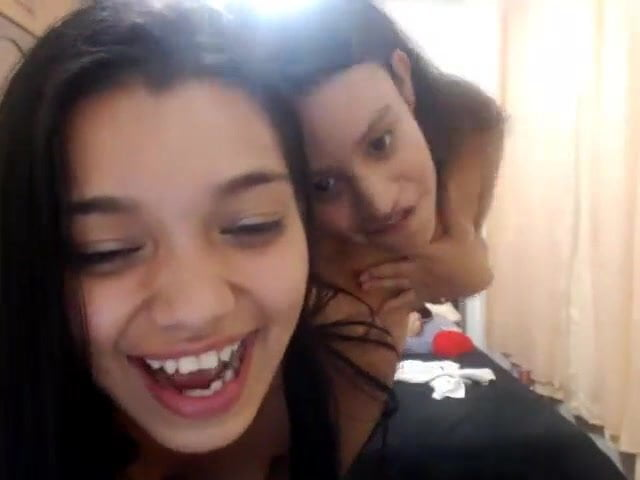 Two cute latina teens on webcam licks each other wet cunts