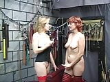 Two sexy, kinky mature babes have some hot, bi fun in the dungeon