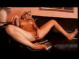 Blonde chick smokes cigarette and plays with toys