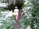 Naked under a railway bridge