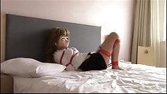 kigurumi tied up on bed 3