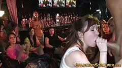 Amateur babes devouring big cock at a strip club