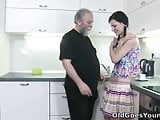 Karina kneels before both of her men and takes their cum all