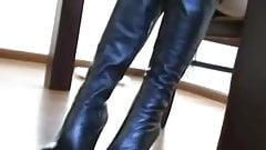 sexy black leather boots under the desk