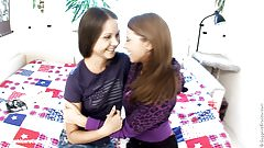 Young lesbian babes Candy C and Vanda L fuck on the bed by