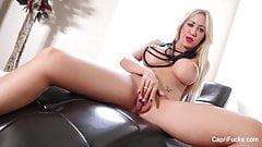Capri rubs her tight wet pussy