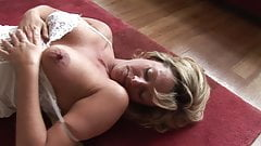 Mature blonde babe with perfect big boobs in lingerie