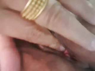 Thai granny 67 years old fingering her pussy