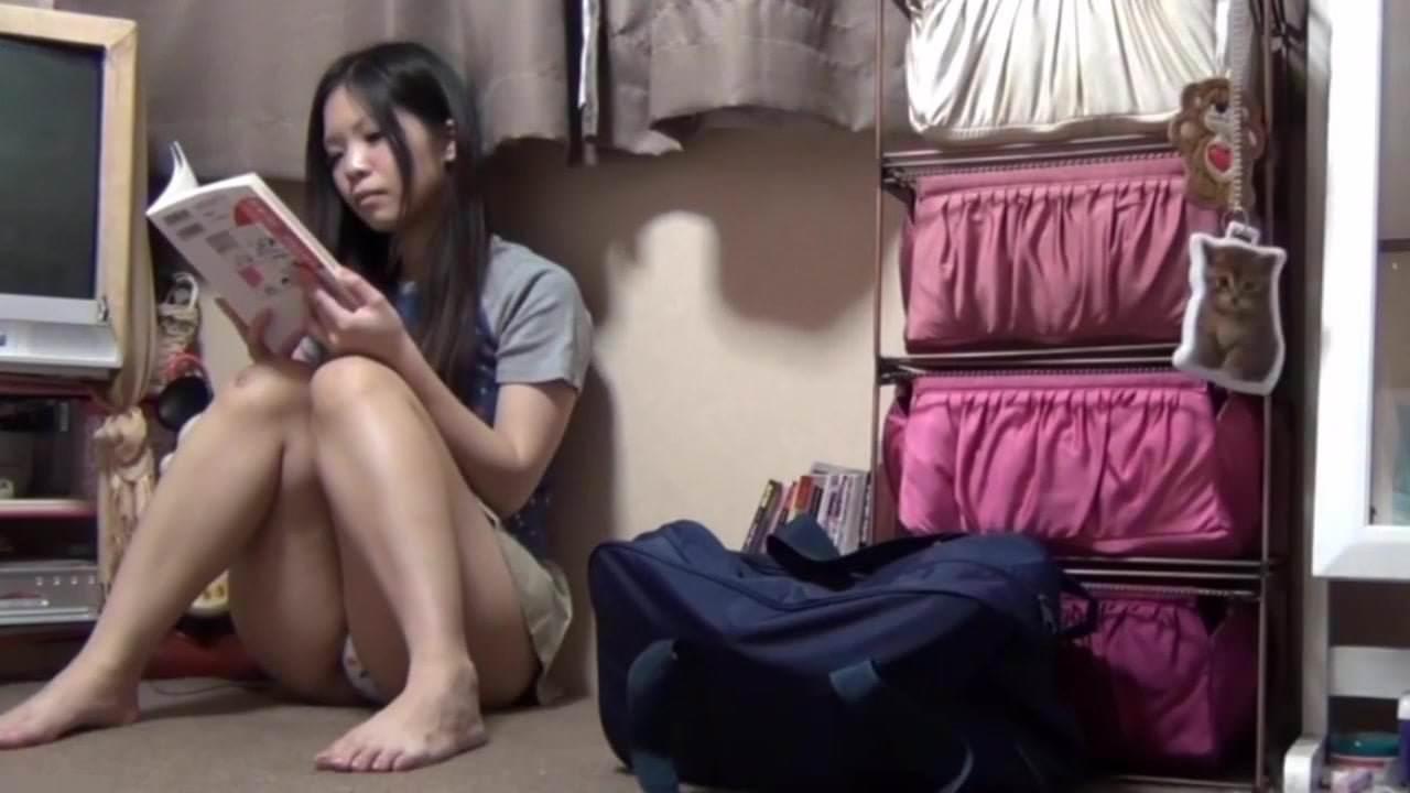 Naked asian girl playing gameboy