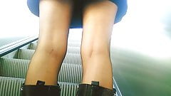 Upskirt on escalator 33