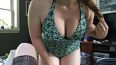 Tits jiggling in a bathing suit