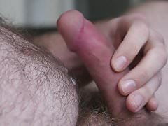Closeup wanking my cock with cumshot in my pubic hair