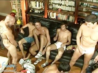 Boys and dads blow meat pipes at a group sex party