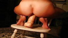 Riding huge dildo in front of friends