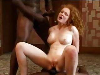 Redhead fully fucked by 2 BBC