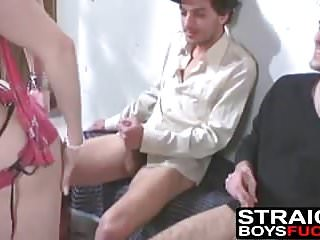 Two guys jack off while a cutie with natural tits strips