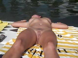 My girlfriendnude sunbathing on the boat