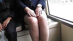 Girl checking her fishnet stockings in a bus