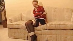 NEWSGIRL STRUGGLING ON A COUCH