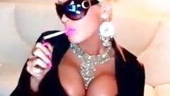 Slut Blonde In Latex Smoking