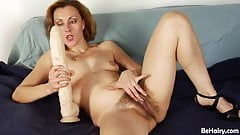 Fucked her hairy hole with a huge dildo