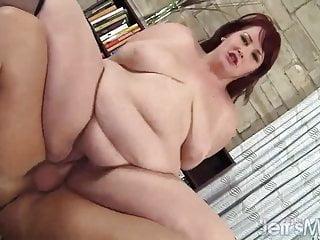 Redheaded plumper Eliza Allure drains a fat cock