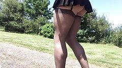 pleated black school skirt walk in public .