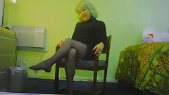 Crossdresser dangles her shoes and poses