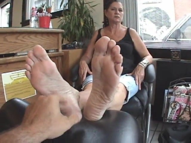Lesbian girlfriends playing with feet and pussy