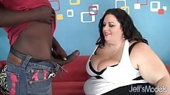 Dark haired Desiree Devine's huge body is fucked interracial