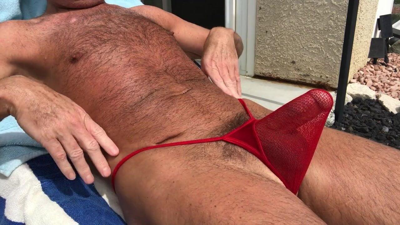 Nude men sunbathing