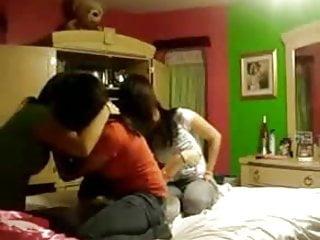 Four girl having fun in a bed