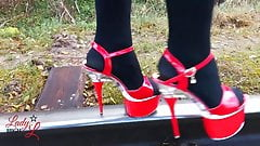 Lady L walking metal road with sexy red high heels!