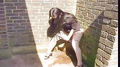 Girl Peeing Behind Building