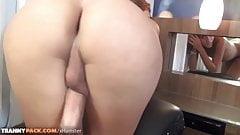 Redhead tranny in schoolgirl outfit strokes big cock till