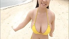 Busty asian in yellow bikini