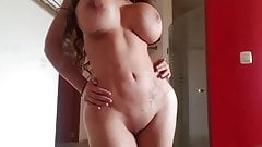 Big tits stripping