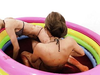 These girls get really naughty when playing in a kiddy pool full with jello