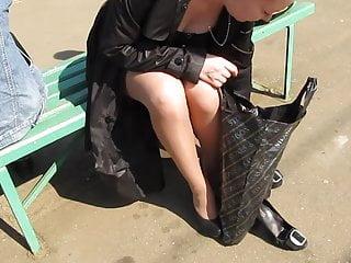 Girl in tan stockings without panties changing shues