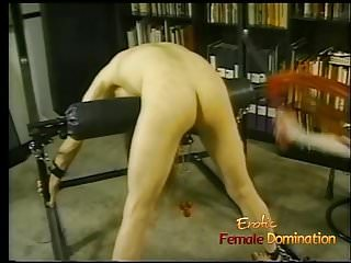 Horny dude with long hair enjoys being whipped by his domina