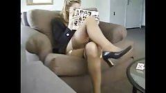 Cute blonde slut smoking in stockings and suspenders