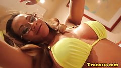 Spex trans in a bikini plays with her bigtits