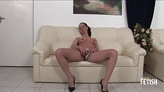 Skinny brunette MILF fingering and fisting her hairy pussy