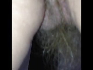 long pussy hair hainging from her pussy and ass.