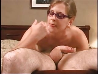 Shameless girl in glasses gives blowjob - cum on face