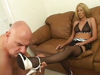 Beautiful blonde hottie sucks a dick and gets her toes licked