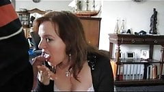 Mature woman drinks a thick cum load from a martini glass