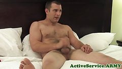 Handsome army jock tugging his dong