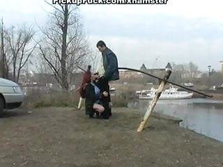 Redhead student sucks on the banks of the river for all to s