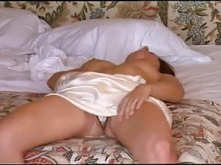 Brunette in white satin nightie masturbates